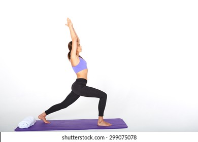 pretty brunette in active wear on white background making yoga