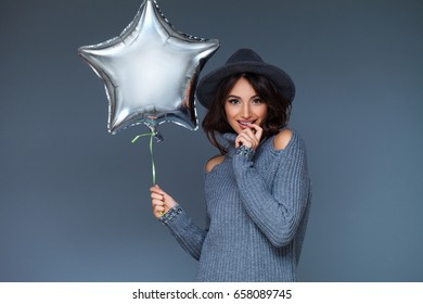 Pretty brunette with a balloon