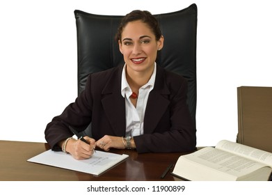 Pretty brunette business woman at her desk doing research. Isolated against white.