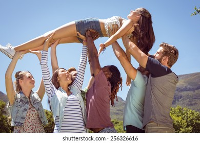 Pretty brunette crowd surfing on a sunny day