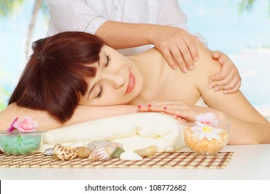 Pretty brunette doing massage at the spa