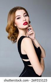 Pretty brunette female model face posing in studio