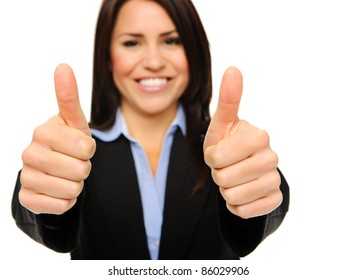 Pretty brunette in formal business attire giving the thumbs up, focus on hands isolated on white