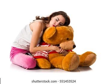 Pretty brunette girl with pajamas sleeping