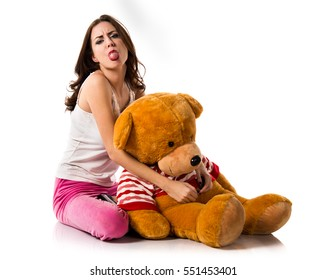 Pretty brunette girl with pajamas taking out his tongue