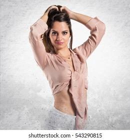 Pretty brunette girl posing on textured background