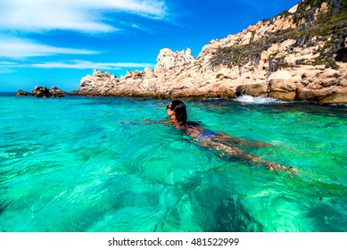 Pretty brunette girl relaxing in the water
