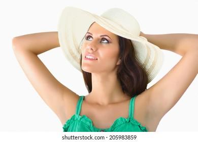 Pretty brunette girl wearing large hat