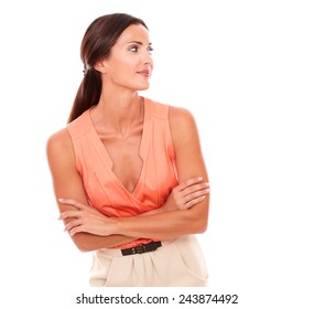 Pretty brunette lady looking to her left in white background - copyspace