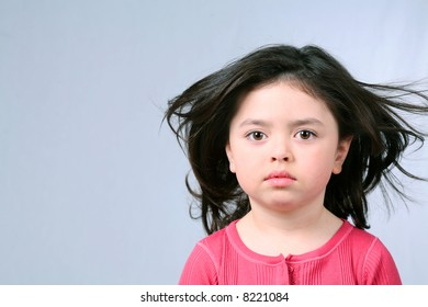 pretty brunette little girl with big brown eyes