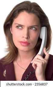 Pretty brunette secretary  with telephone headset