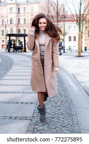 Pretty brunette stylish smiling happy woman have fun and smiling in winter cold weather on the street.