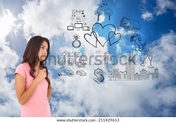 Pretty brunette thinking against bright blue sky with clouds
