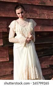 Pretty brunette in a vintage Victorian dress