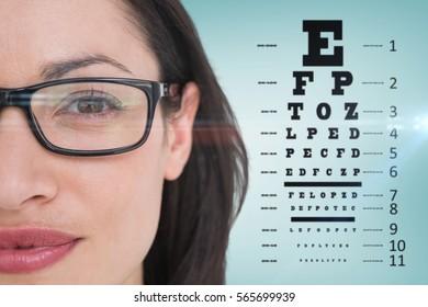 Pretty brunette wearing eye glasses against blue vignette background