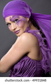 pretty brunette wearing purple outfit and matching makeup