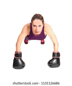 A pretty brunette woman with black boxing gloves doing some punch-ups