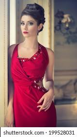 pretty brunette woman in a red dress