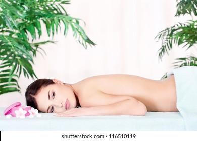 Pretty brunette woman resting after massage