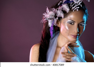 pretty brunette woman wearing white and silver accessories