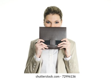pretty buisnesswoman hiding behind a diary
