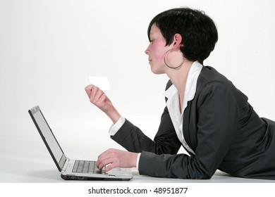 Pretty business lady in black buying on internet in a white background