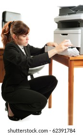 Pretty business lady or student clearing a printer paper jam.