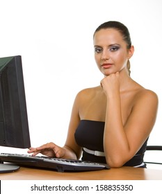 Pretty business woman at office desk with a white background