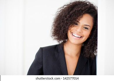 Pretty business woman smiling at camera with closeup