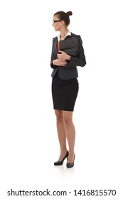Pretty businesswoman standing with folders handheld, full size side view portrait.