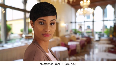 Pretty businesswoman In upscale restaurant posing for portrait