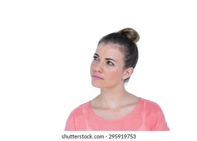 Pretty casual brunette looking away on white background