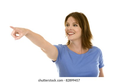 pretty casual brunette pointing with hand on white background