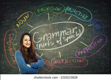 Pretty casual woman teacher smiling and holding arms crossed over blackboard background chalk written english grammar parts of speech. Opportunity to study system and structure of a language.
