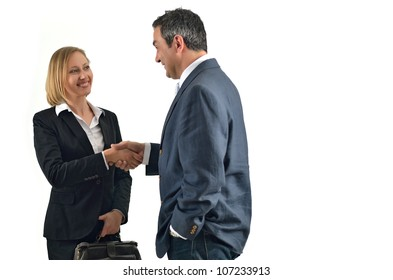 Pretty caucasian business woman shaking hands with a businessman. Isolated on white.