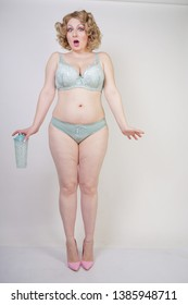 399ff5a1495 Pretty caucasian chubby woman with plus size body and pale skin wearing  green lace sexy underwear