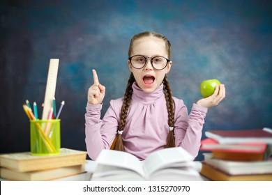 Pretty Caucasian Elementary Schoolgirl Do Homework
