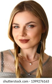 Pretty Caucasian Female Model Promotion Shooting. Beauty Studio Front Headshot. Woman with Enigmatic Smile Looking at Camera. Beautiful Blonde with Two Long Hair Braids Closeup Shot