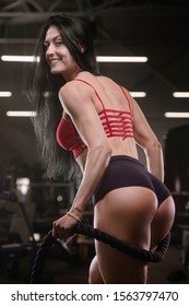 pretty caucasian fitness woman pumping up butt ass booty legs muscles workout fitness and bodybuilding concept gym background exercises in gym naked torso