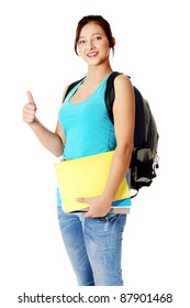 Pretty caucasian girl with backpack holding notes and showing her thumb-up. Isolated on white.
