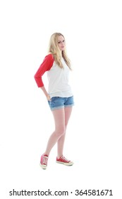 pretty caucasian girl with long blonde hair, wearing casual shirt, shorts and sneakers. standing pose against a isolated white background.