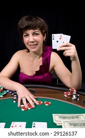 Pretty caucasian girl shows two aces in casino poker