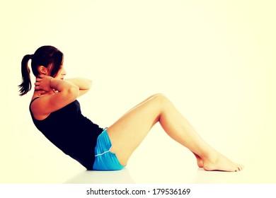 Pretty caucasian teen girl doing exercises.