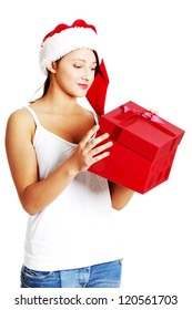 Pretty caucasian teen girl opening a gift. Isolated on white.