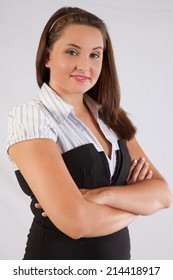 Pretty Caucasian woman with a happy expression for the camera, with her arms crossed