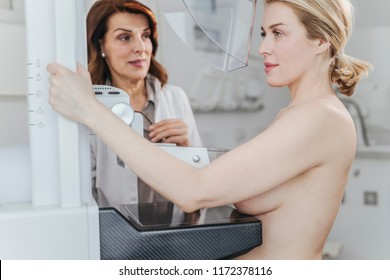 Pretty Caucasian woman having mammography exam.