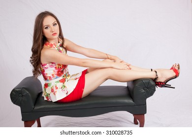 Pretty Caucasian woman reclining and  looking thoughtful