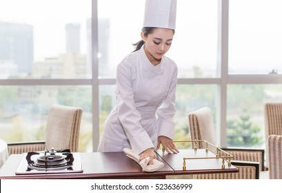 pretty charming elegant asian Japanese female chef woman cook lady prepare French cuisine meal, trendy vogue wasted girl model in chef uniform kitchen clothing as fashion portrait