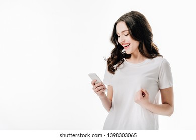 pretty cheerful girl in white t-shirt using smartphone isolated on white