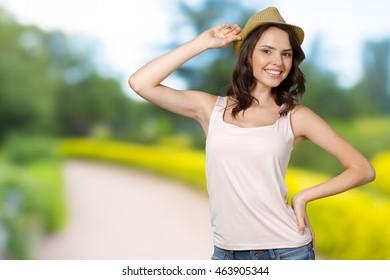 Pretty cheerful woman in hat